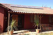 Casa unifamiliar  05/2013, Copiapó, Chile   Potencia: 1.38 kWp  Producción de energía: 2'515 kWh/año   Ahorro de CO2: 1.05 t/año    Tipo de instalación: Sobre el tejado, Redes