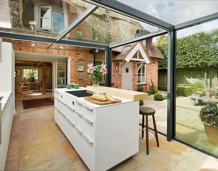 Perfect This thatched cottage got a glass box extension for the kitchen