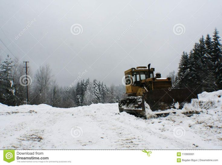 Crawler tractor bulldozer mountain landscape. Photo about clearing, forest, lawn, create, tractor, stands, photo, conditions, complex, cold, snow, crawler, mountain - 110900001