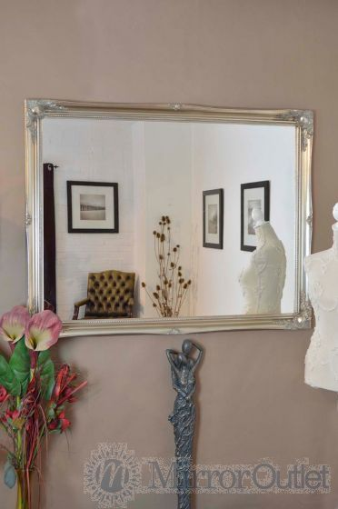A classic silver hand finished French-style frame. The design boasts ornate detailing in all four corners and sides. This mirror has a glass size of 4ft x 3ft 122cm x 91cm and has an overall size of 4ft 6 x 3ft 6 137cm x 107cm.