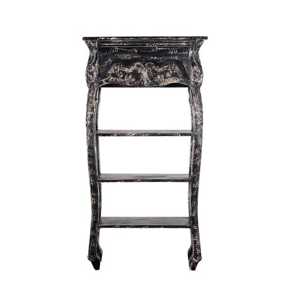 Ornate, Late-Victorian design and a distressed black finish blend effortlessly to make the Alice Bookshelf a real storyteller of any space it's used in. The Alice Bookshelf features a straightforward mango wood structure with stylish antiqued mirror and brass hardware, and four interior shelves for ample storage. The mango wood used to hand-build the Alice Bookshelf is the byproduct of commercial mango plantations. The most commercially sought-after mangoes grow in the early years of a mango…