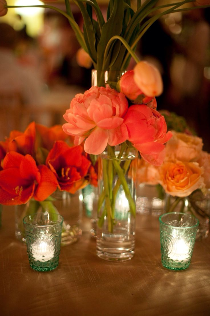 Coral centerpieces charm peonies amaryllis