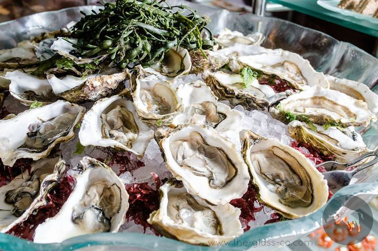 Deluxe oysters presentation with large free form buffet bowl designed by www.the-glass-co.com for Baltschug Kempinski Moscow