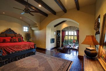 Tuscan style Master Suite with dropped Sitting Room :: love the bed wall arch detail...