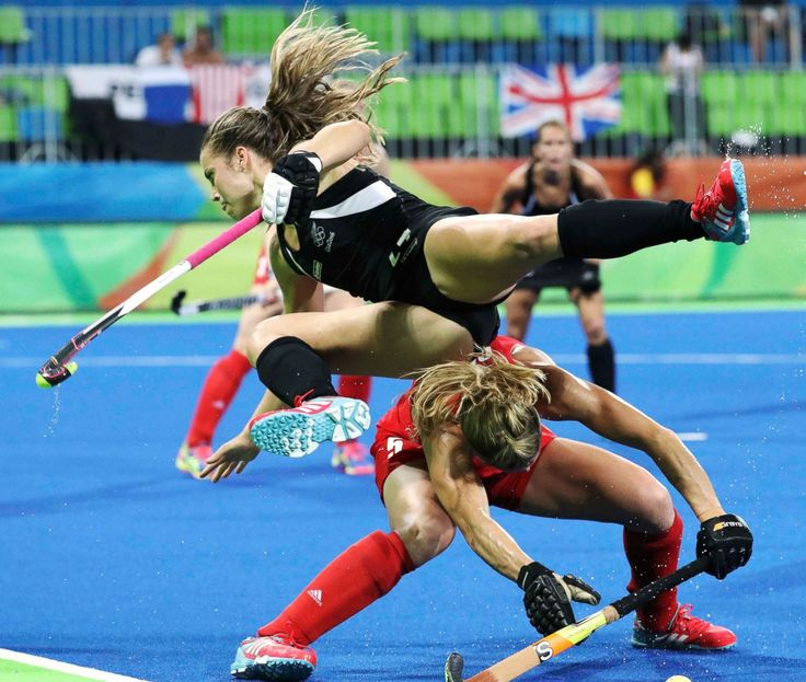 Rose Keddell of New Zealand (top) stumbles over Crista Cullen of Great Britain…