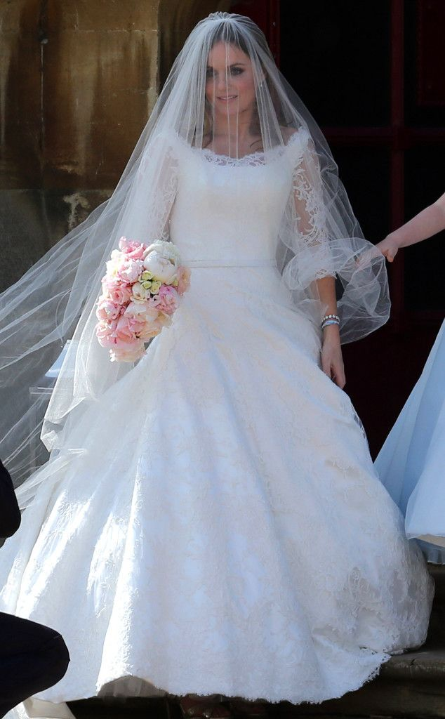 Geri Halliwell from Celeb Wedding Dresses  The Spice Girl got married on May 15 in a sweeping, lace-embroidered Phillipa Lepley confection featuring a sheer illusion neckline and sleeves.