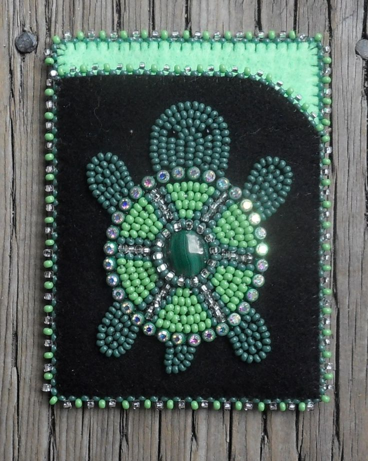 Turtle card case with banding and a green stone that I made. Carmen Dennis (Tahltan)
