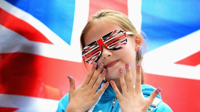 A young Great Britain fan shows off her country's colours at the women's 63kg Weightlifting final at ExCeL.