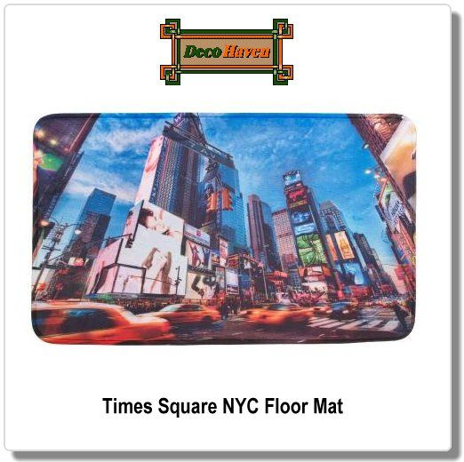 Times Square NYC Floor Mat - The electric ambiance of New York Citys' Times Square can be yours everyday! This polyester mat features a digitally printed scene of tall buildings, bright lights, and racing taxi cabs that will make you feel like youre in the center of the city.