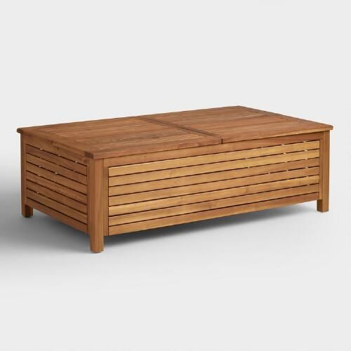 The bold beauty of our contemporary outdoor coffee table comes from solid acacia wood construction highlighted with a natural finish. With a chunky, slatted profile, this multifunctional coffee table features four lift-off lids that reveal storage underneath and also double as serving trays.