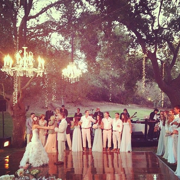 This is it. Outdoor forest/garden wedding - love the shiny wood dance floor, vintage chandelier, everything. ♥
