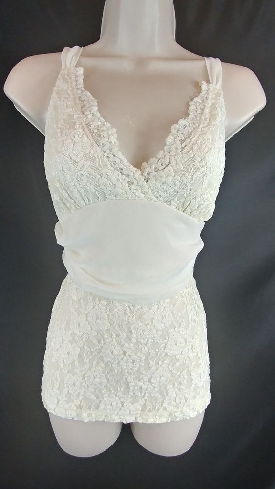"~Fredericks of Hollywood. ~Ivory lace camisole with adjustable chiffon straps and a wide chiffon sash that ties in the back. ~Ladies Size M - 32"" around the bust. 28"" around under the bust. 