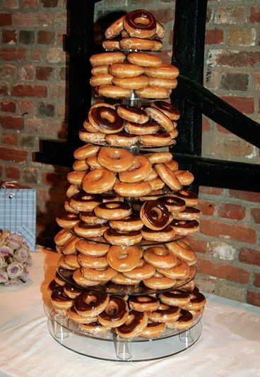 Doughnut cake - 20 amazing alternative wedding cake ideas   -would work great for cinnamon rolls, too.  maybe a shorter, but wider tower would be a better display