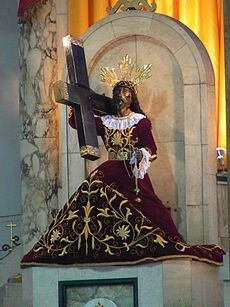 The Black Nazarene (Spanish: El Nazareno Negro, Nuestro Padre Jesús Nazareno, Filipino: Poóng Itím na Nazareno, Hesus Nazareno[1]) is a life-sized image of a dark-skinned, kneeling Jesus Christ carrying the Cross enshrined in the Minor Basilica of the Black Nazarene in the Quiapo district of the City of Manila, Philippines.[2]  The Black Nazarene was carved from a dark wood in the 16th century in Mexico, and then transported to the Philippines in 1606.[2][3] It depicts Jesus en route to his…