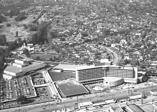 Beverly Hills, California: On the upper left is J.W. Robinson's Department Store, on the right is the Beverly Hilton.