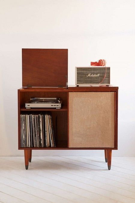 mid-century modern draper media console stores vinyl records, a turntable, and a marshall speaker