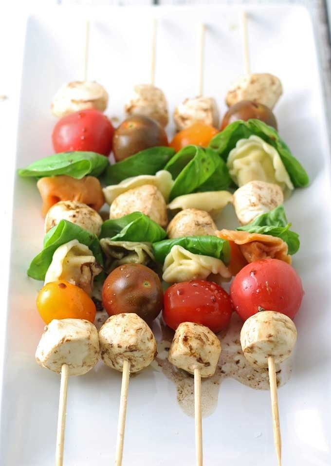 Caprese Tortellini Skewers are a fun appetizer on a stick! Perfect for parties and barbecues !