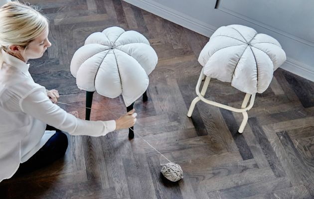 Here's a DIY idea that takes 5 minutes to put together and makes hard seats seriously comfy. All you need is a pillow and a length of string (we like the rustic twine version). Then loop your string over the pillow and stool, making 8 equal sections and tie a firm knot at the top. Finished!