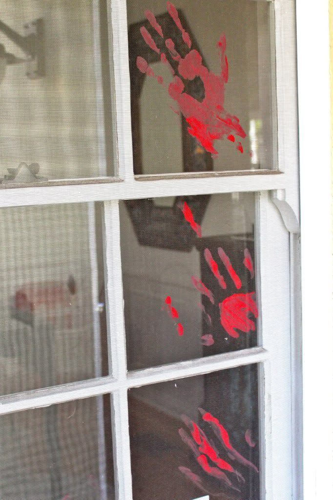 """Bloody Handprint – If you're up against a Halloween decorating deadline, red poster paint will be your new best friend. Slap some red """"bloody"""" handprints onto the window, done and done.{found on prudentbaby}."""