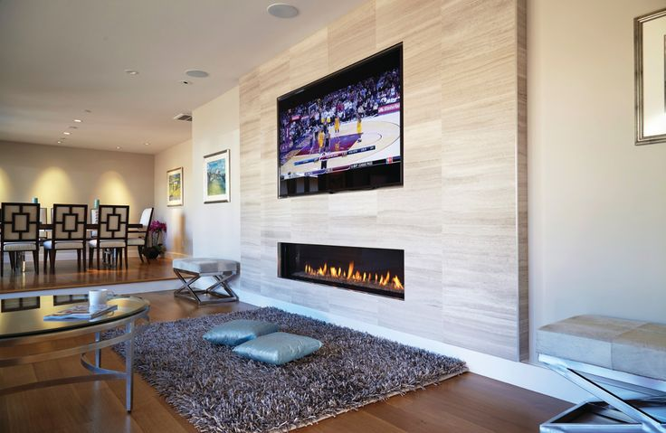Create the ultimate living space with help from one of our beautiful fireplaces. We offer many design options at Ortalheat.com #Modern #InteriorDesign