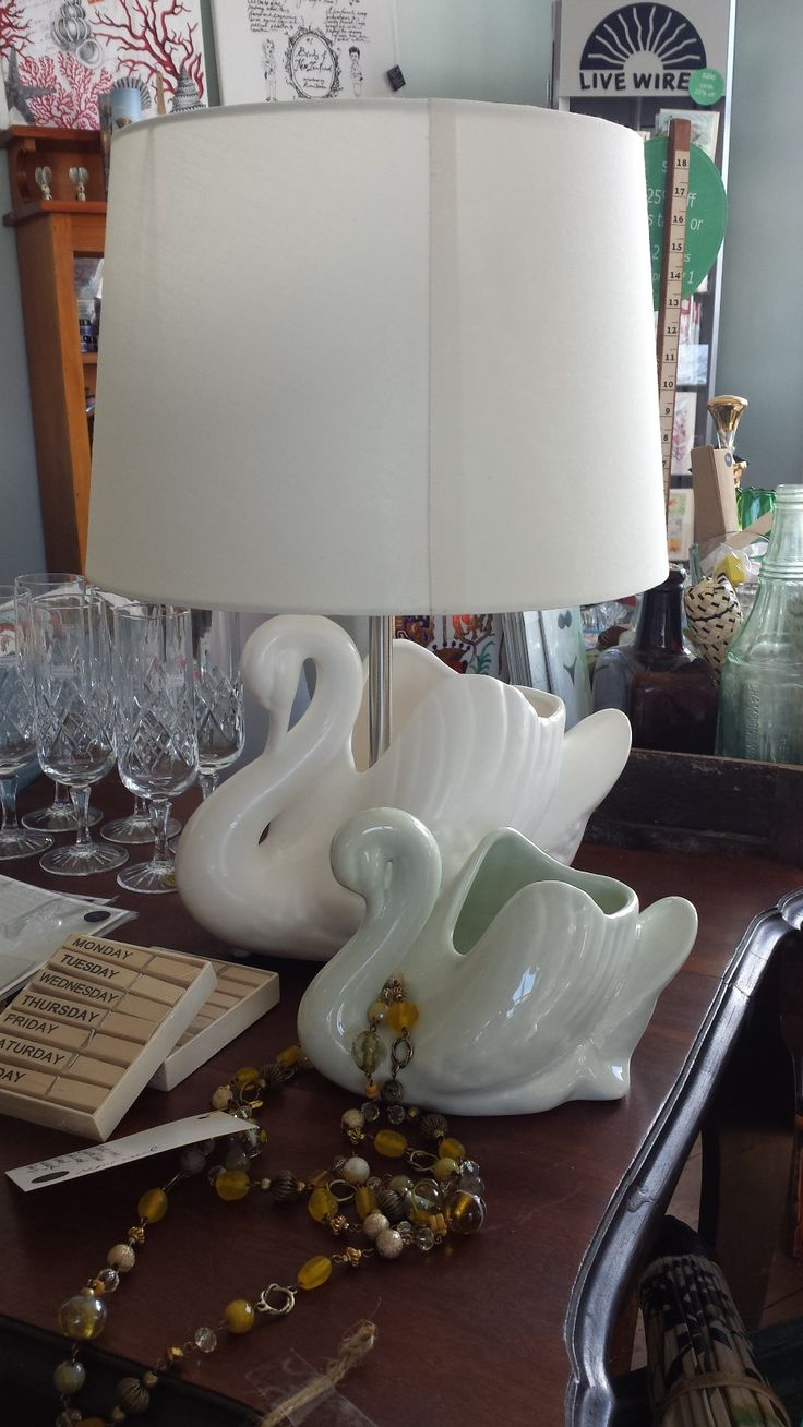 White ceramic swan lamp and little sister in celadon green. Pictured at Bird of Prey, Gisborne, New Zealand.