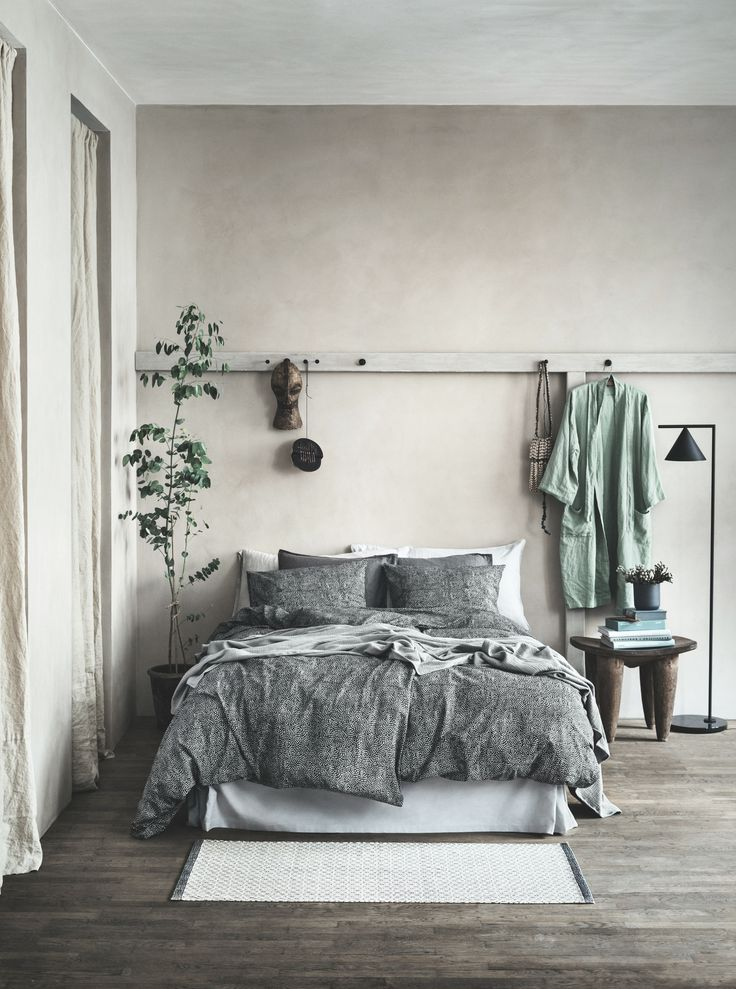 Gorgeous, suede-textured bed cover, gray wood floors, soft gray walls and hints of washed sage green in this relaxing bedroom.
