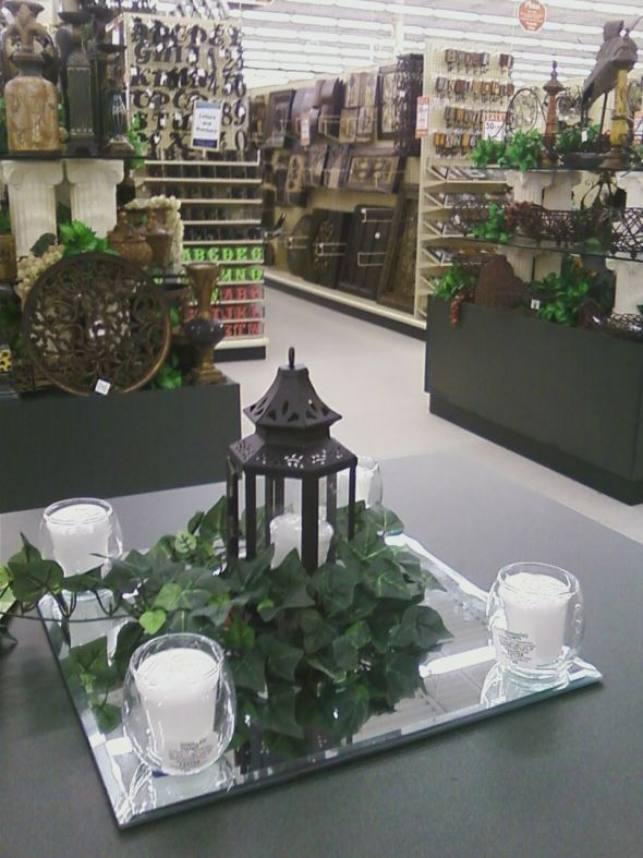 My fiance and I saw a picture of a centerpiece similar to this and knew we had to give it a shot! Our goal was to do all our centerpieces with a budget of $100.  We found our lanterns on a site for $2.40/piece and then found Ivy at Hobby Lobby for 50% off. The place where we are having the reception is providing the candles and the mirrors for the centerpieces.  Total cost: $87.  When we put it all together this is what we got!    posted by Jenny7568 2 months ago   Here is the website where…