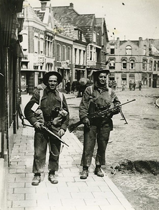 Canadian soldiers pose for the camera in Delfzjil, Netherlands....the one on the right is a Bren Gunner.