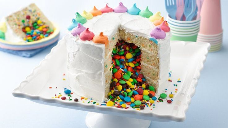 A fun cake filled with a colorful sweet surprise that tumbles out when you cut into it.