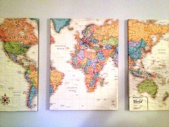 """Lay a world map over 3 canvas, cut into 3 pieces. Coat each canvas with Mod Podge and wrap the maps around them. Let dry and hang on the wall. Then add pins to all the places you've been."" Love this."