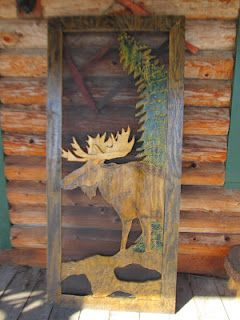This Cabin Style screen door features a hand carved Moose with 3-D antlers and a curved pine tree.