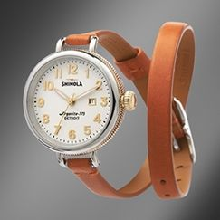 The Birdy 34mm orange leather watch with white face showcases a classic dial, elevated design and enduring materials highlighted by a Swiss quality quartz Argonite 775 movement, which is hand assembled in Detroit from over 50 Swiss-made parts.