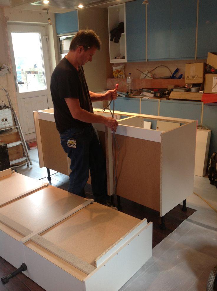 Kitchen island unit being installed