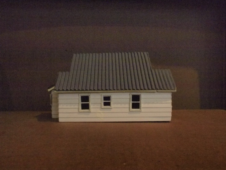 This is my latest miniature house made from different types of cardboard. The house is a mini replica of a friend's home that I stayed in September 2011, in Kalispell, Montana.