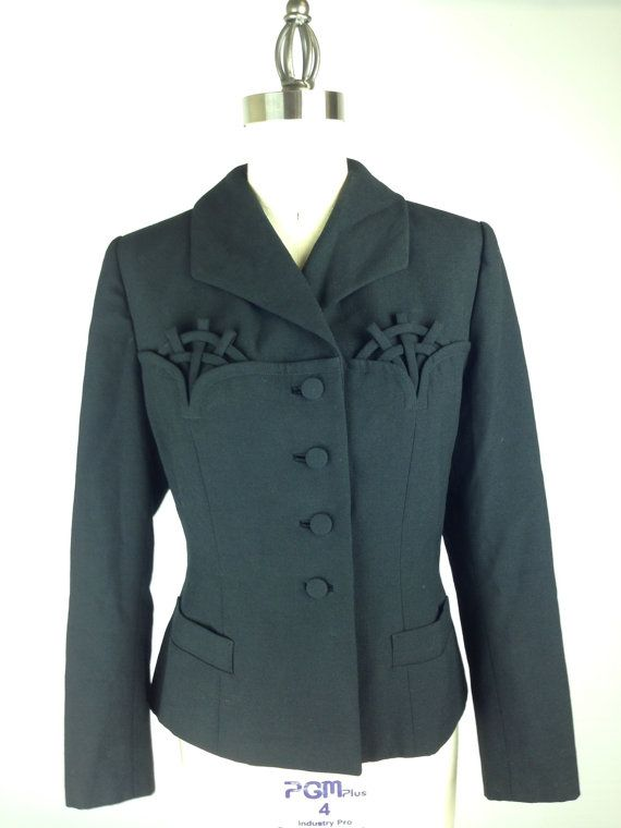 This beautiful 1940s Wool Blazer in black features a unique basket detail!
