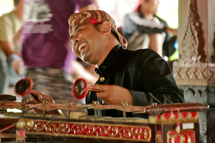 Gamelan orchestra musician goes wild in Java, Indonesia.