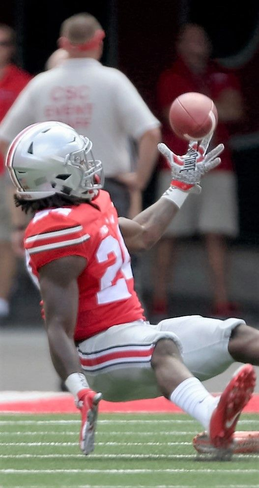 Ohio State Buckeyes safety Malik Hooker (24) leaps to intercept a pass intended…