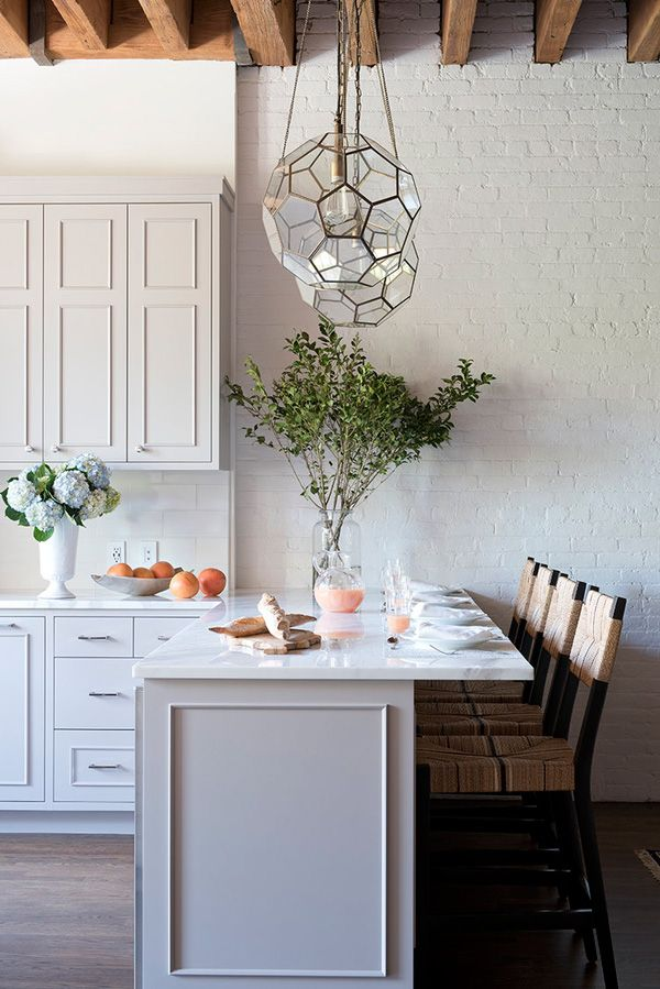 threshold interiors Loft Kitchen in Dove Tale by Farrow & Ball and  Arteriors Light Fixtures, stools by Serena & Lily.