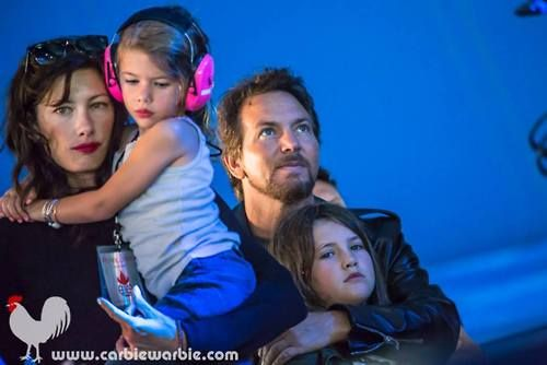 Eddie vedder at a concert with wife Jill mccormick and their two daughters Olivia and Harper.