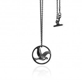 Bird in Circle Necklace - Handcrafted Danish Design. Pernille Vinderskov's black oxidised sterling silver version of her Bird in Circle pendant necklace is as elegant and simple in design and theme as her polished sterling sterling silver version, but this one lends a slightly darker hue. The black bird inscribed into the circle shines like onyx. This necklace will look stunning with a white dress or blouse for any formal or casual occasion. http://www.nuuru.com/en/bird-in-circle-ox.html
