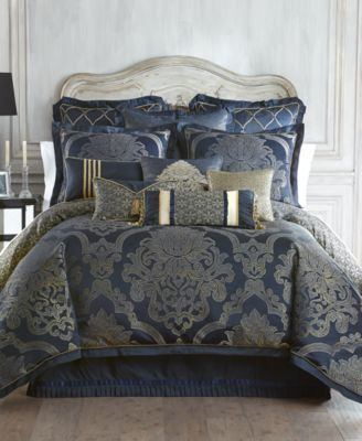 Indulge in drama. The Waterford Vaughn comforter boasts over-scaled damask embroidery in gold hues with hints of pale blue against a ground of rich sapphire. Details of cord trim, a scroll embroidery