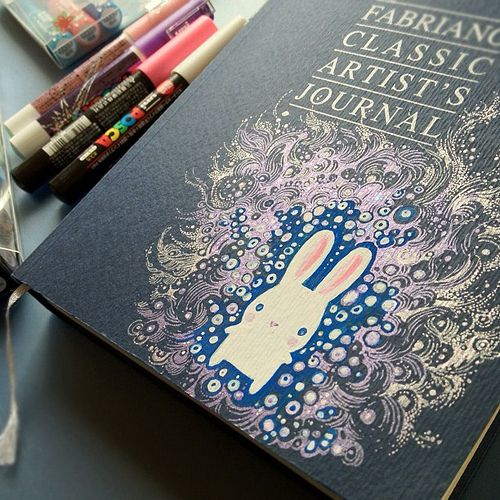 Trying out Poscas on the Fabriano Artist's journal cover. ... note to self to look into Poscas markers, they seem pretty cool