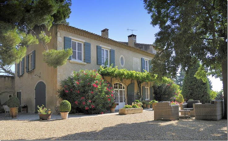 a typical French gravel terrace along with a pergola.