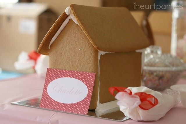 Decorate a gingerbread house at a Valentine's Day Party #valentines #gingerbread