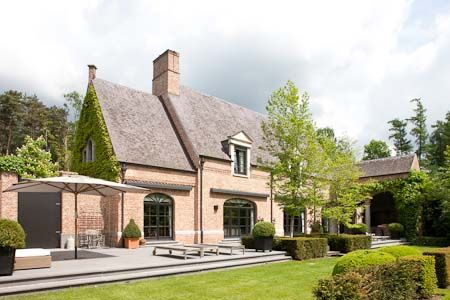CURB APPEAL – another great example of beautiful design. Belgian style. Steel windows brick cornice. Mansion at Wijnegem.