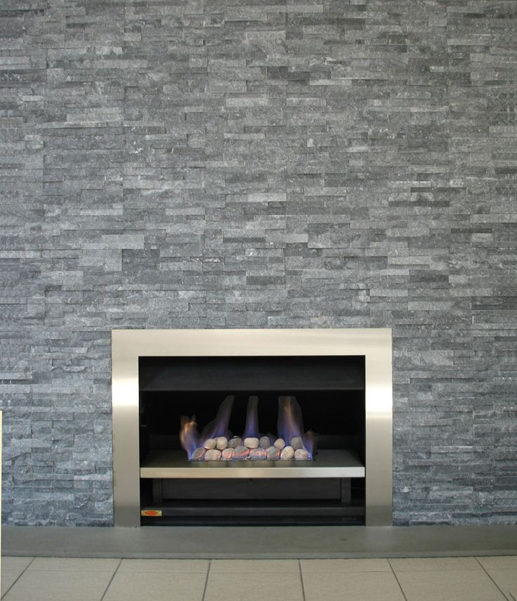 love the mix of modern with traditional stone for the fireplace
