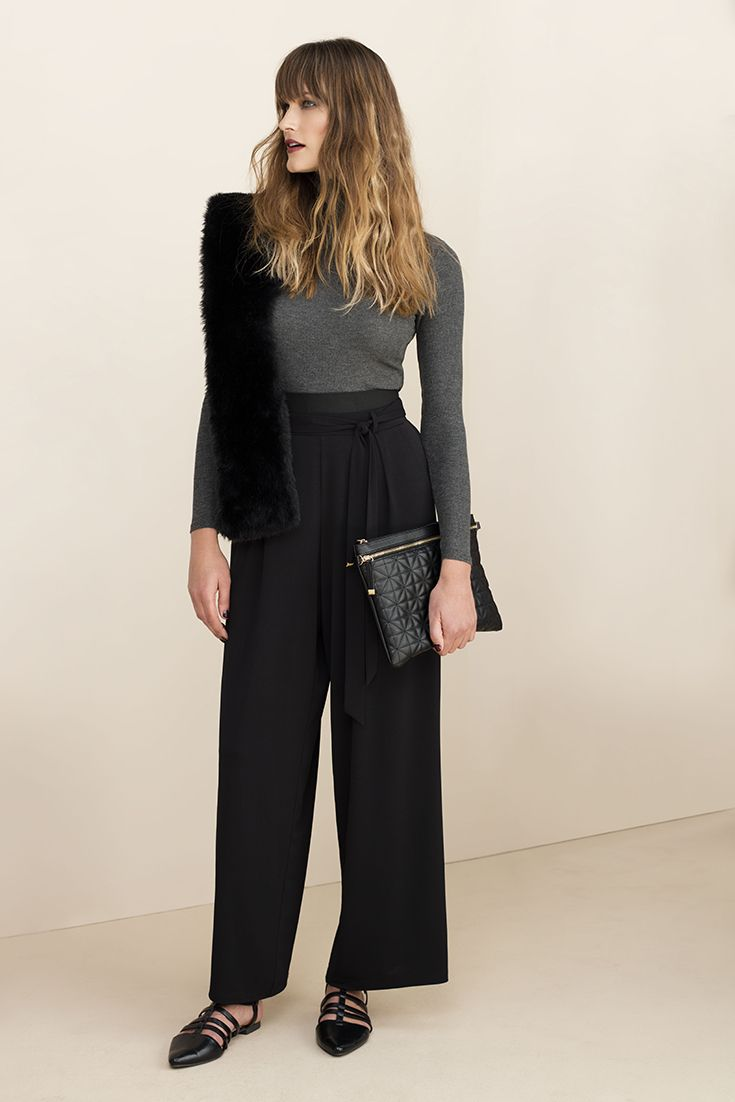 The classic wide leg pants, wear with a fitted polo neck or soft romantic blouses and a pop of fur (fur scarf).