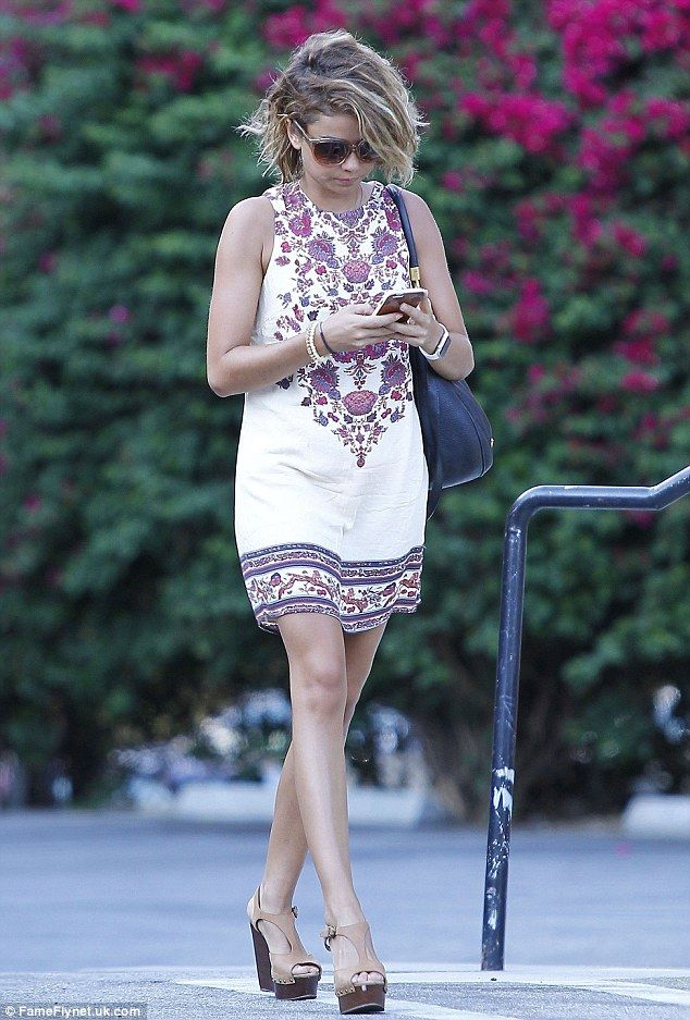 Bronzed beauty: Sarah Hyland donned a sleeveless summery frock at a Los Angeles tanning sa...