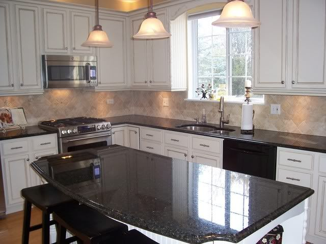 1000 images about kitchen redo on pinterest subway tile for Black kitchen cabinets with black granite countertops