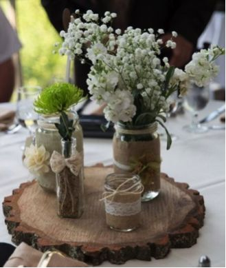 Hello #Rustic Bride! These are #Rustic Mason Jar Centerpieces; a great #DIY project. Get the jars you need to create this look at #AnneMarieWeddingFavors.